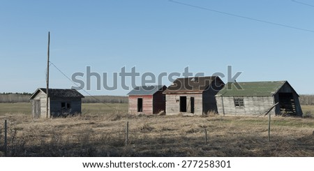 Old abandoned buildings in a field, Manitoba, Canada - stock photo