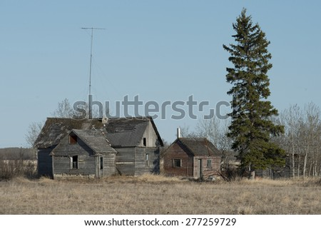 Old abandoned buildings on a field, Manitoba, Canada - stock photo
