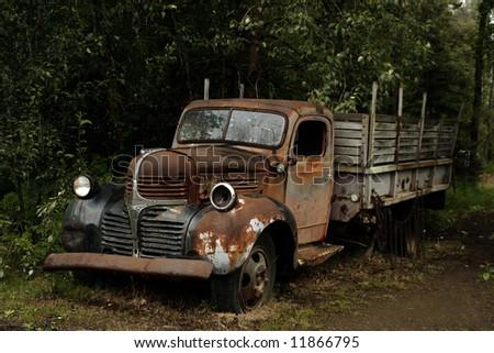 Old, abandoned car - stock photo