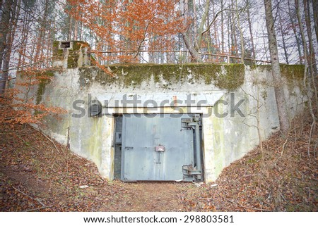 Old abandoned Cold War bunker in forest, Podborsko in Poland. - stock photo