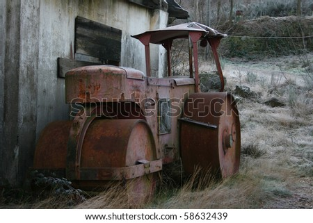 old abandoned compactor - stock photo
