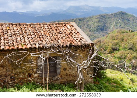 old abandoned country house in Sicilian mountains in spring - stock photo