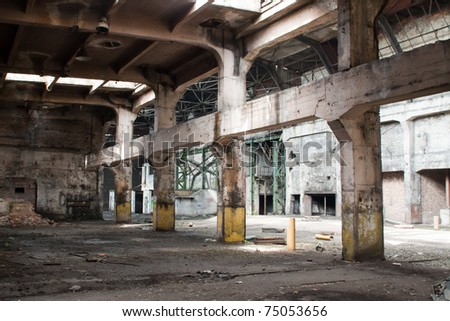 old abandoned factory during demolition - stock photo