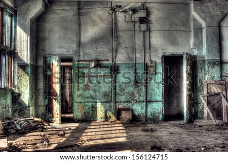 Old abandoned factory, indoors.  - stock photo