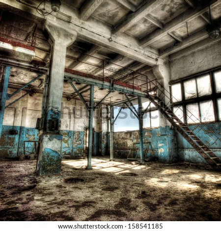 Old abandoned factory, indoors  - stock photo