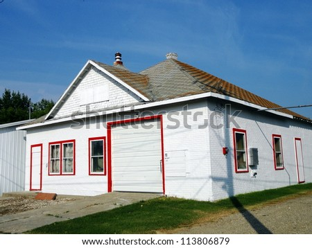 old abandoned farm buildings fire hall - stock photo