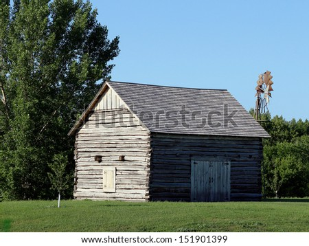old abandoned farm buildings log home  - stock photo