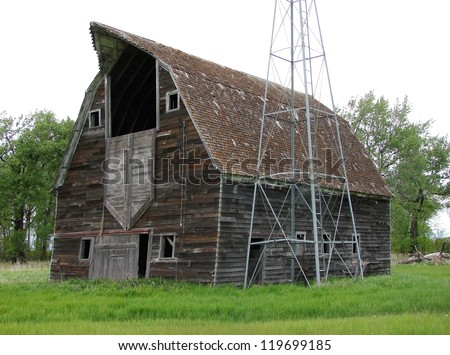 old abandoned farm buildings windmill - stock photo