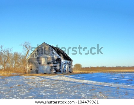 old abandoned farm buildings winter - stock photo