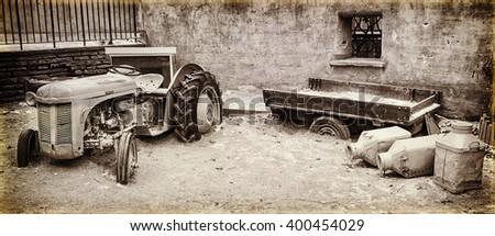 old abandoned farm equipment (imitation vintage photo) - stock photo