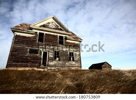 Old abandoned farm house - stock photo