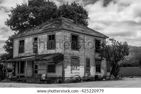 Old abandoned farm house, black and white.