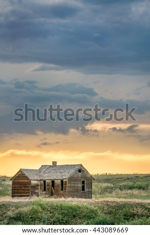 old abandoned farmhouse on a prairie, St Vrain State Park near Longmont, Colorado - stock photo