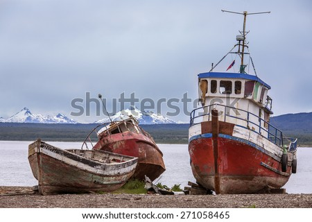 Old abandoned fishing boats near Puerto Natales in Patagonia in southern Chile, South America. Puerto Natales is located at the opening of Ultima Esperanza Sound, northwest of Punta Arenas. - stock photo