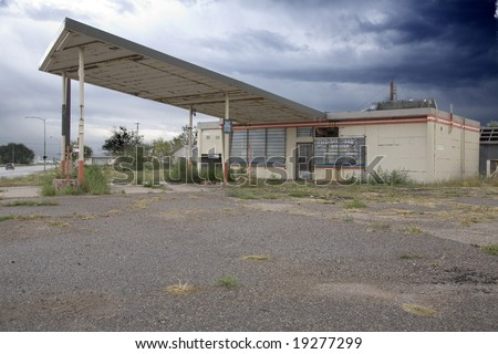 old abandoned gas station - stock photo