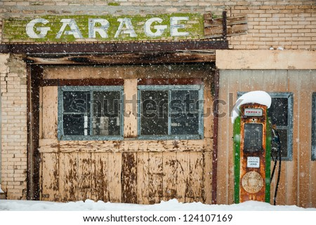 Old Abandoned Gas station with gas pump - stock photo