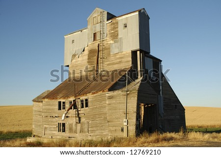 Old abandoned grain elevator - stock photo