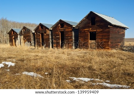 old abandoned granaries in late winter - stock photo