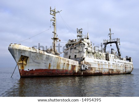 Old abandoned guano covered Russian trawler in Walvis Bay, Namibia - stock photo