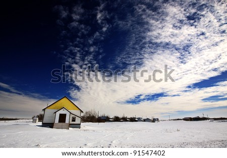 Old Abandoned Homestead in Winter Saskatchewan - stock photo