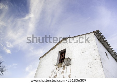 Old abandoned house, detail of an old house with sky - stock photo