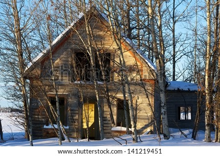 old abandoned house in aspens and snow - stock photo