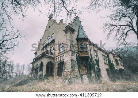 Old abandoned mansion in mystic spooky forest - stock photo