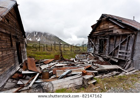 Old abandoned miner houses in alaska - stock photo