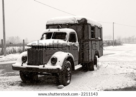 old abandoned old truck in winter - stock photo