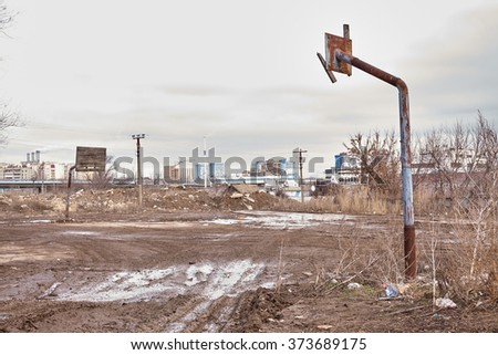 Old abandoned outdoor basketball court town russia - stock photo