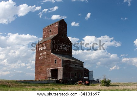 Old abandoned prairie grain elevator found in rural Saskatchewan, Canada. - stock photo