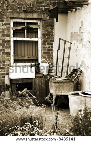 Old abandoned rear of house in sepia - stock photo