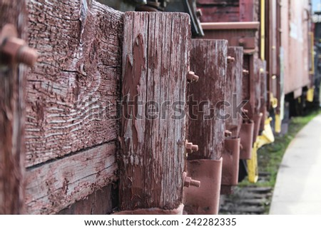 Old abandoned red train track post and rails - stock photo