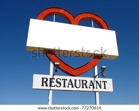 old abandoned restaurant sign with heart shape and room for text - stock photo