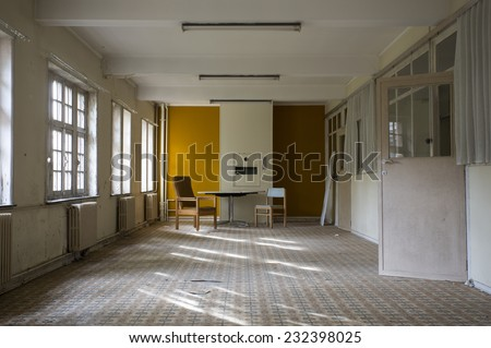old abandoned room in a derelict building - stock photo