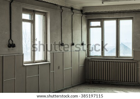 Old abandoned room in creepy factory - stock photo