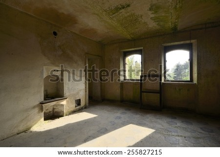 old abandoned room with windows - stock photo