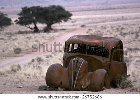 Old abandoned rustic car - stock photo
