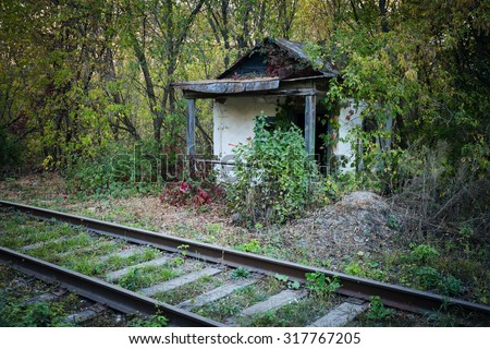Old abandoned shack stationmaster in the forest - stock photo
