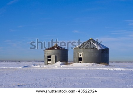 Old Abandoned Silo's on cold Winter Prairie