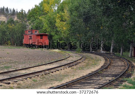Old abandoned train left on railroad tracks - stock photo