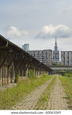 Old abandoned train station in Warsaw, in Background social housing blocks and  Culture Palace