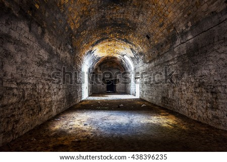 Old abandoned tunnel in the underground wine cellar. Entrance to the catacombs in Odessa, Ukraine. As a creative background for staged dark design - stock photo