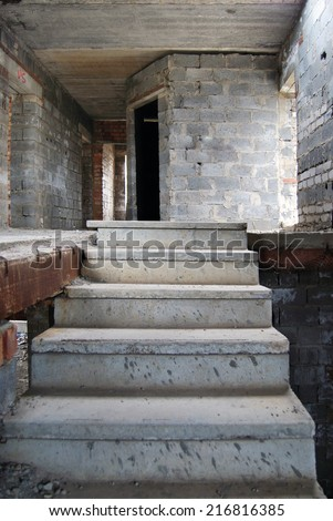 Old abandoned unfinished building with stairs - stock photo