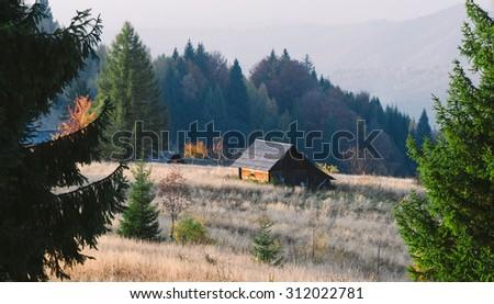 Old abandoned village in the mountains. Autumn landscape. Carpathians, Ukraine, Europe - stock photo