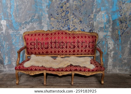 Old abandoned vintage interior with broken sofa