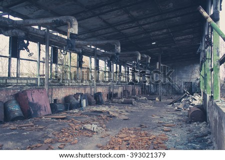 old abandoned warehouse , empty messy factory