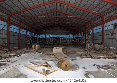 Old abandoned warehouse hangar, nobody - stock photo
