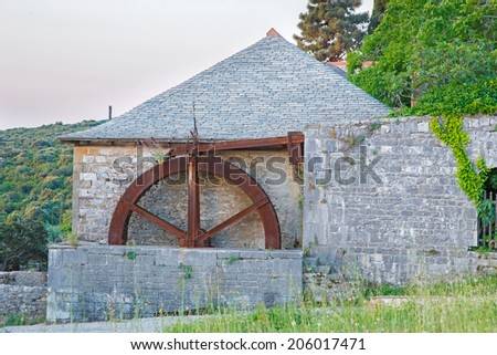 Old abandoned water mill at Megistis Lavras medieval monastery in Holy mount Athos - stock photo