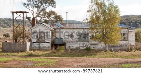 Old abandoned weatherb0ard farmhouse, rural Australia